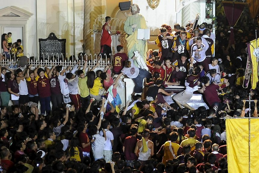 Two people died and hundreds were injured during the festival of the Black Nazarene in the Philippines, where crowds of barefoot people hurled themselves at a statue of Jesus believed to have healing powers, the authorities said. More than a million