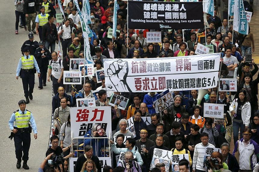 A protest march in Hong Kong yesterday demanding the release of five booksellers who are feared to have been detained by the mainland authorities.