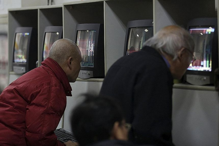 Investors checking stock prices at a brokerage house in Shanghai on Friday. What is worrying investors is the Chinese central bank's vacillating attitude on the yuan..