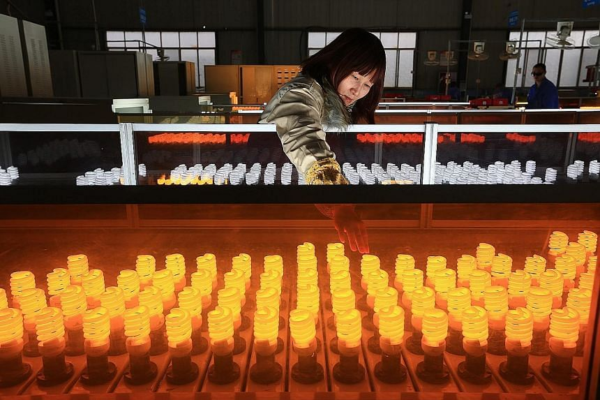 A lightbulb production line in Sichuan province. Key Chinese data due out on Jan 19 could weigh heavily on the local market.