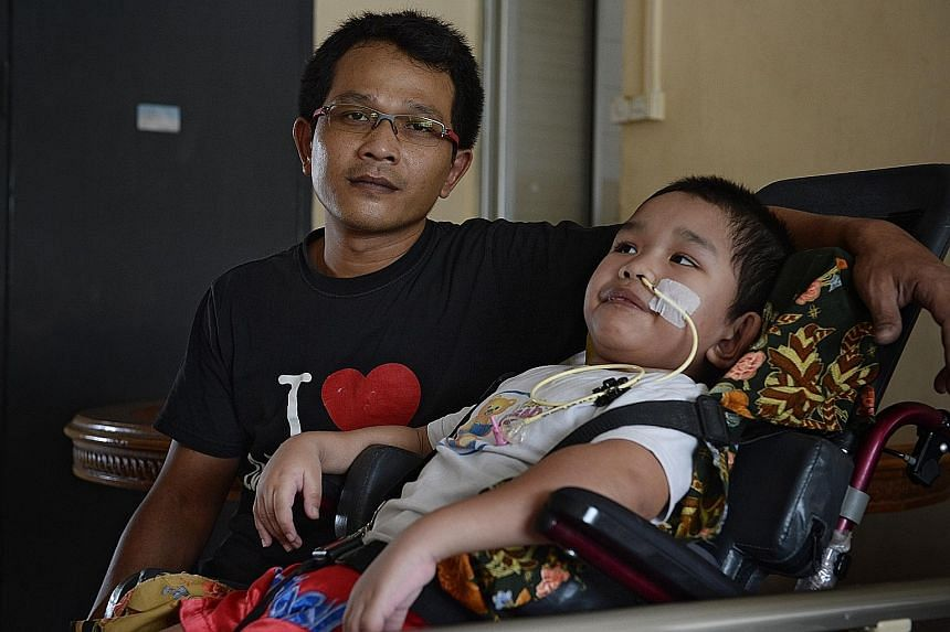 Mr Abdul Halim with his son Syahriz, who spent the last three months warded at KK Women's and Children's Hospital.