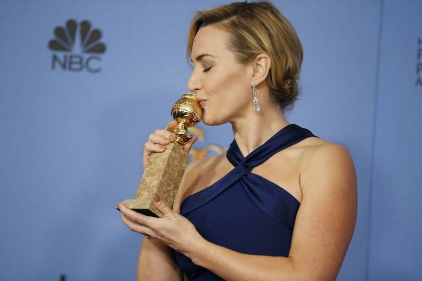 Actress Kate Winslet poses with her award for Best Performance by an Actress in a Supporting Role in any Motion Picture for her role in Steve Jobs.