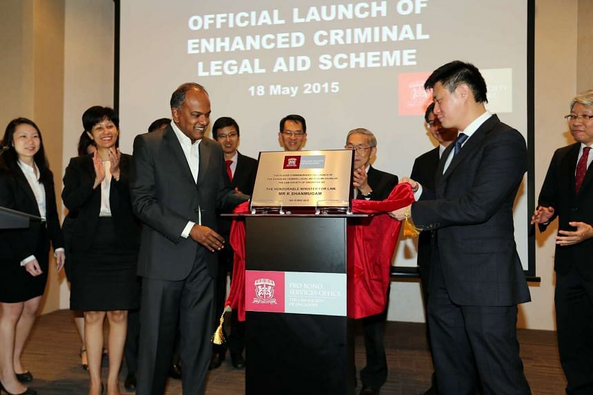 Law Minister K. Shanmugam launched the enhanced Criminal Legal Aid Scheme with Law Society president Thio Shen Yi (right) at the State Courts on May 18, 2015.