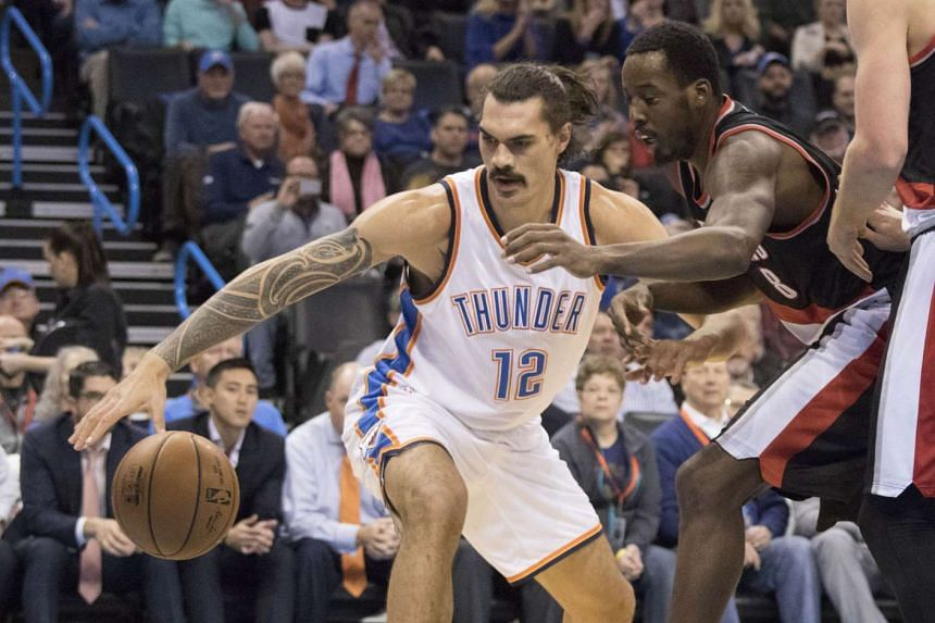 Portland Trail Blazers' Al-Farouq Aminu (right) trying to recover the ball he knocked away from Oklahoma City Thunder's Steven Adams on Dec 16, 2015.