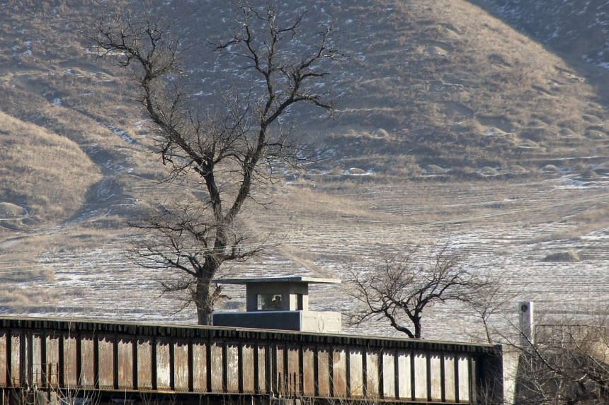 North Korean soldiers in an observatory post are seen from the Chinese side in Tumen, China.