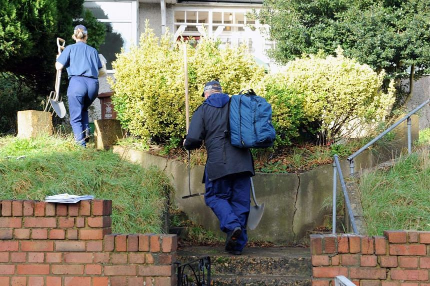 Police and forensics inspect the home where the bodies of former EastEnders actress Sian Blake and her two young sons were found in Erith, Kent.