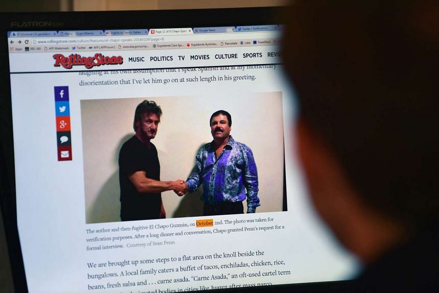 """A man reading an article about drug lord Joaquin """"El Chapo"""" Guzman, showing a picture of him (right) and US actor Sean Penn in Mexico City, on the Rolling Stone website on Saturday."""
