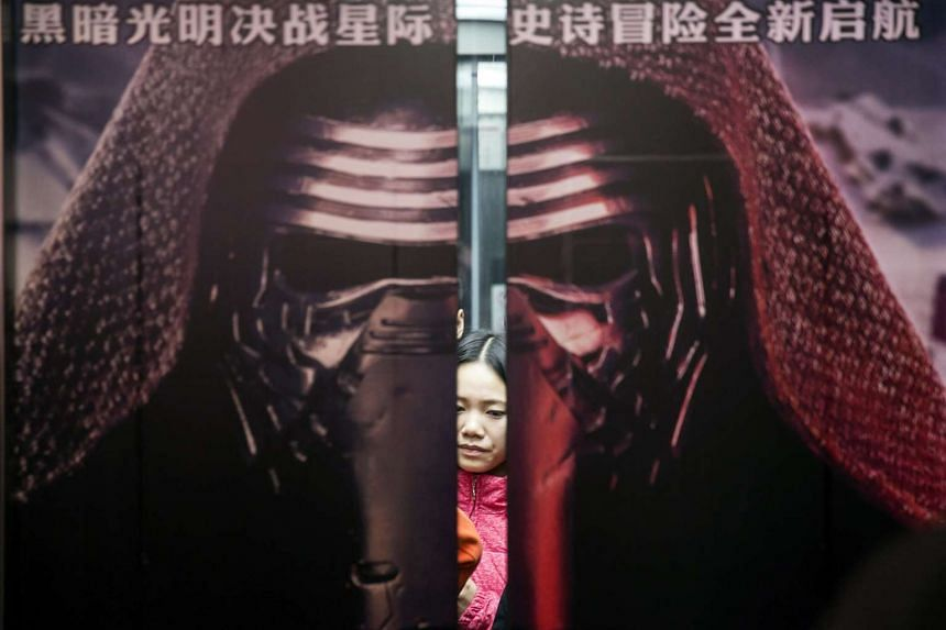People take an elevator to attend the first public screening of Star Wars: The Force Awakens at the Wanda cinema in Shanghai on Friday.