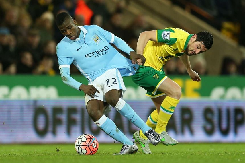 City's Nigerian forward Kelechi Iheanacho getting the better of Norwich's Scottish midfielder Graham Dorrans in their FA Cup tie. Iheanacho netted the second goal after a stylish strike from Spaniard Sergio Aguero and Belgium's Kevin de Bruyne comple