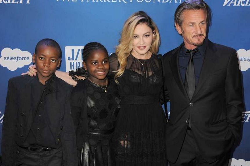 Singer Madonna, with her children (from left) David Banda and Mercy James, stepped out in support of ex-husband Sean Penn at the actor's Help Haiti Home fundraiser in Beverly Hills last Saturday. E! Online reported rumours that sparks were again fl