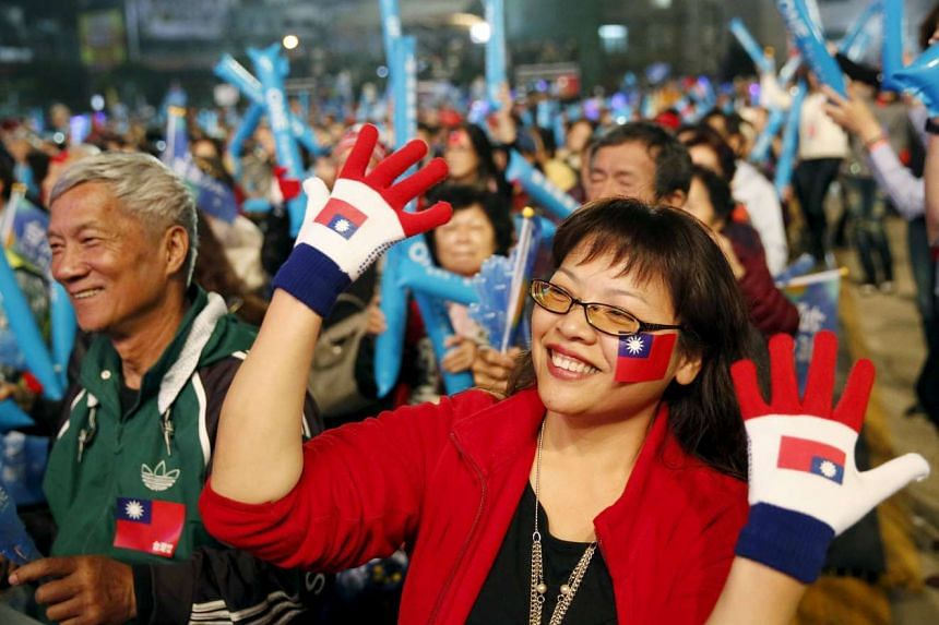 Supporters of Taiwan's ruling Kuomintang (KMT) at a rally ahead of Jan 16 Taiwan's election in Taipei on Jan 10, 2016.