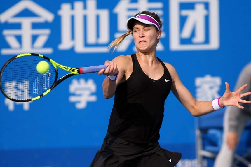 Eugenie Bouchard of Canada hits a return during the singles quarterfinal match at the Shenzhen Open WTA tennis tournament.