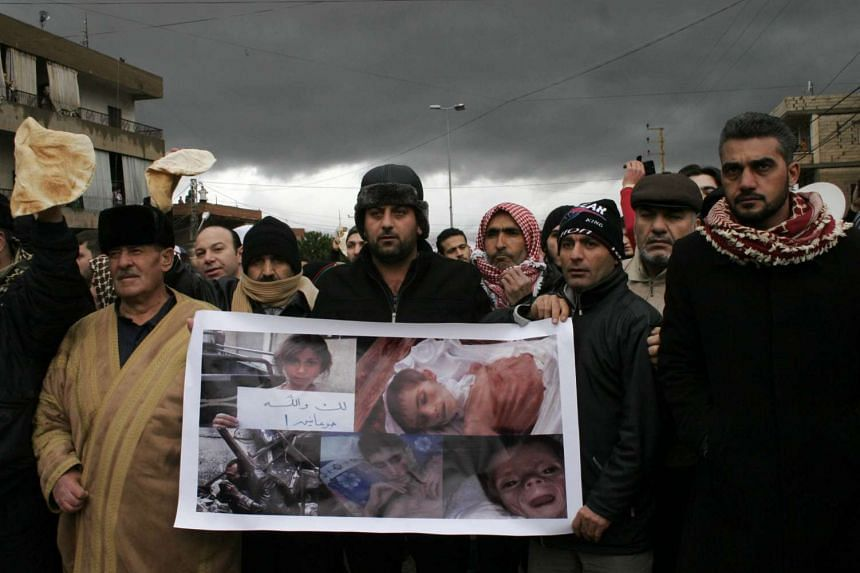 Lebanese protesting against the ongoing siege imposed on the Syrian town of Madaya, at the Masnaa crossing on the Lebanon-Syria border on Jan 8, 2016.