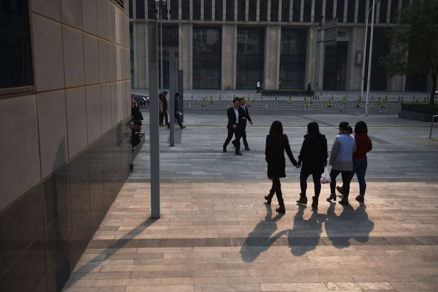 Office workers in a commercial complex in Beijing on Nov 4, 2015.