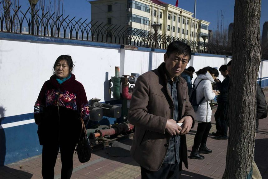 Family members of detained lawyers and their colleagues at the Hexi District Detention Centre on Jan 8, 2016.