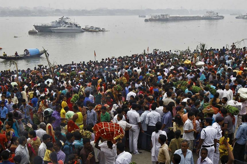 Hindu devotees on the banks of the river Ganga during a religious festival on Nov 17, 2015.