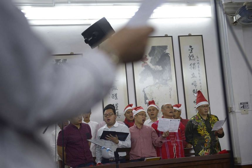 Choir members singing during service at the Karen Baptist Church, which holds its services in rented premises at Kim Tian Christian Church.