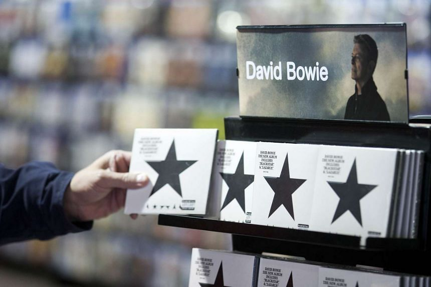 A customer picking up a copy of Blackstar, the latest album by David Bowie, on Jan 11, 2016.