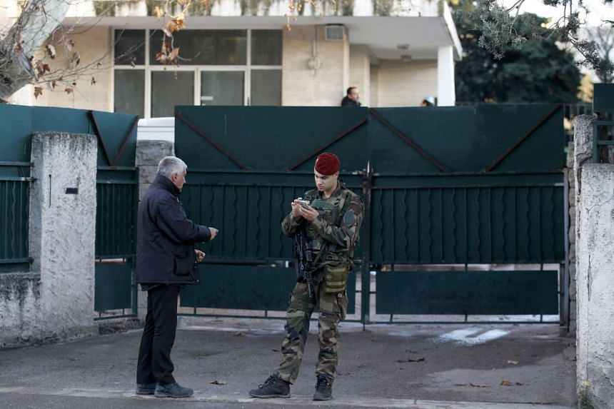 A French soldier secures the access to a Jewish school in Marseille after a teenager attacked a Jewish teacher, on Jan 12, 2016.