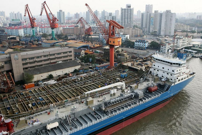An aerial view of ships being constructed at a shipyard on the Huangpu River in Shanghai, China, on Dec 3, 2006.