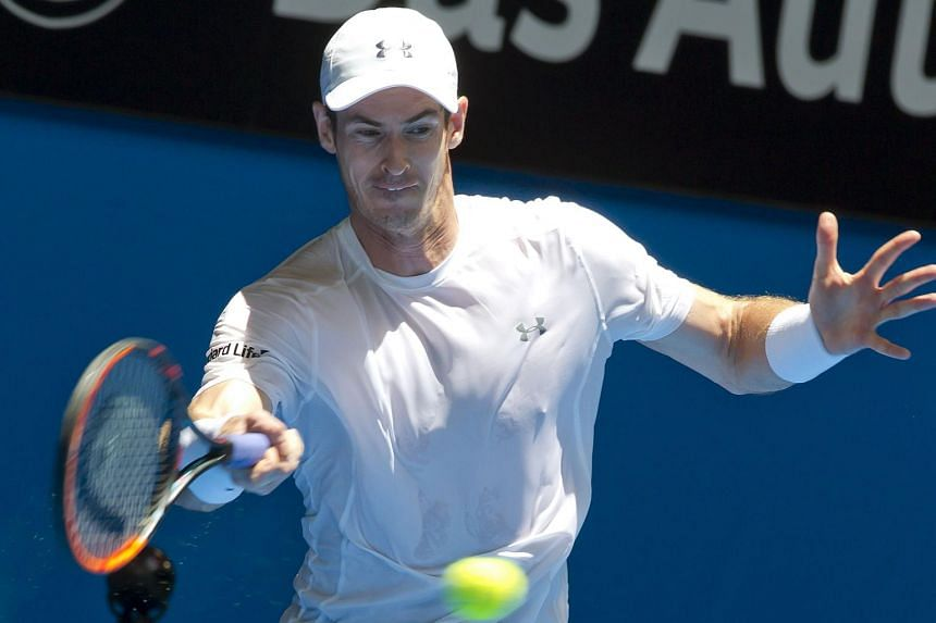 Britain's tennis star Andy Murray hits a return against Alexander Zverev of Germany at the Hopman Cup tennis tournament in Perth on Jan 8, 2016.