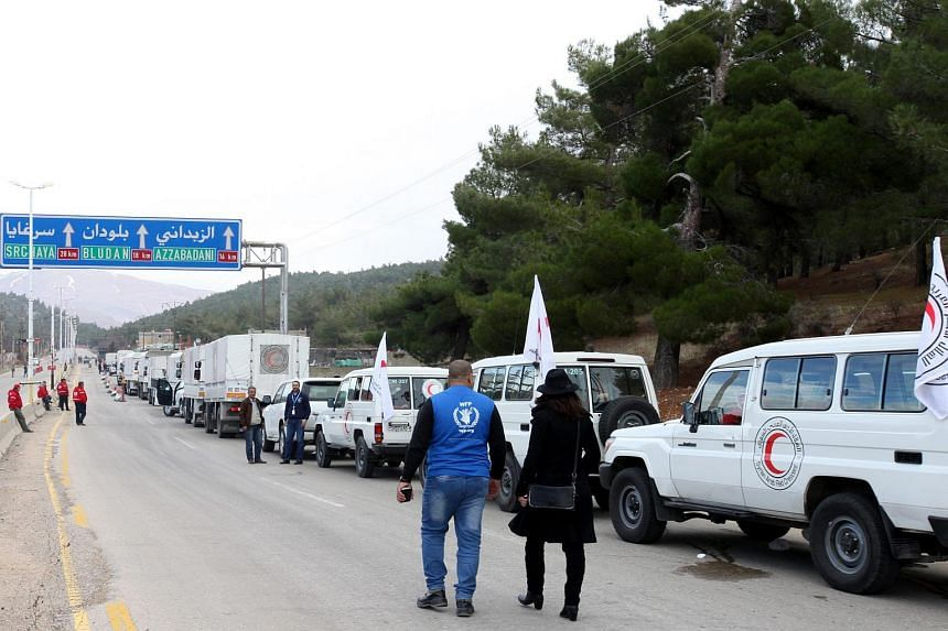 A convoy of cars loaded with food and medical supplies moving towards Madaya, Syria, on Jan 11, 2016.