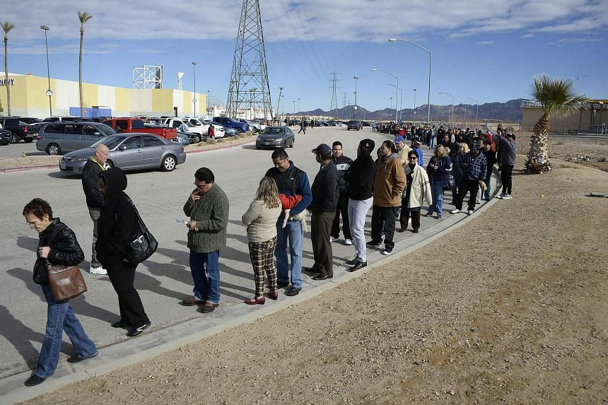 Hundreds of people waiting in line to purchase tickets for the Powerball lottery at a store in San Bernardino County, California.
