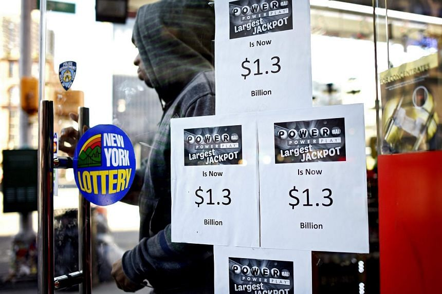 Signs promoting the multi-state Powerball lottery jackpot on a store's door in New York.