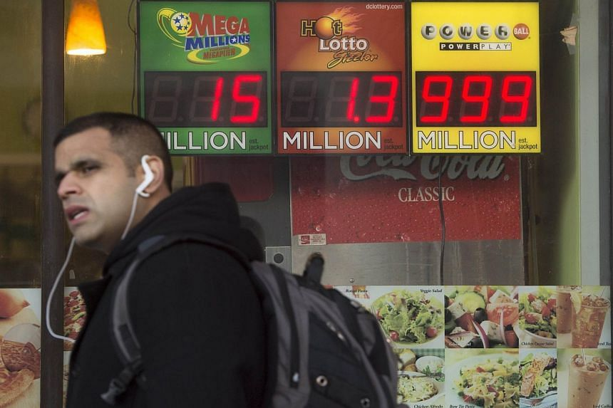 A man walking past a sign showing the Powerball prize when it was worth US$999 million.