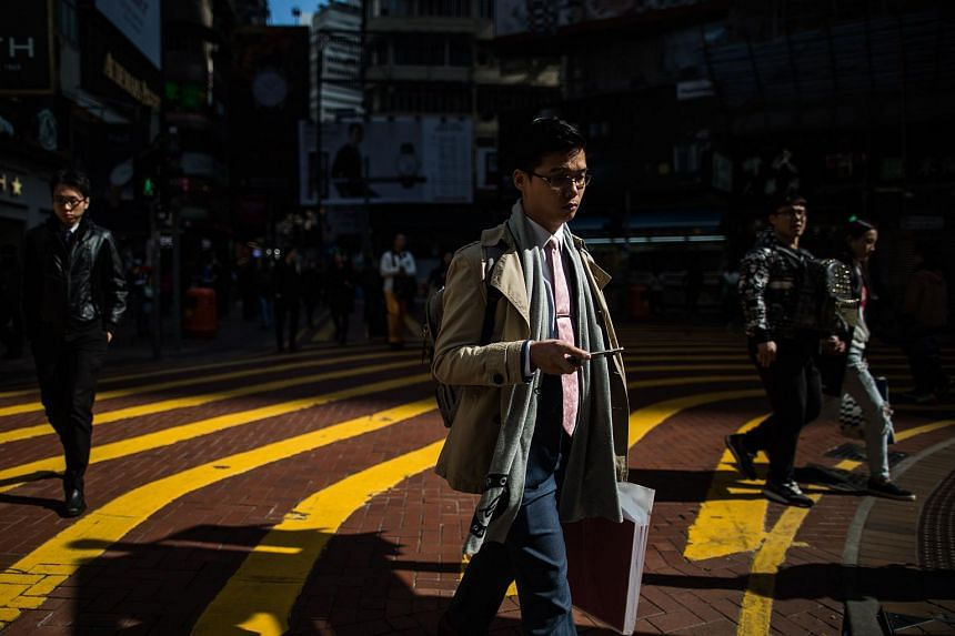 Pedestrians walking in the Causeway Bay district of Hong Kong on Dec 17, 2015.