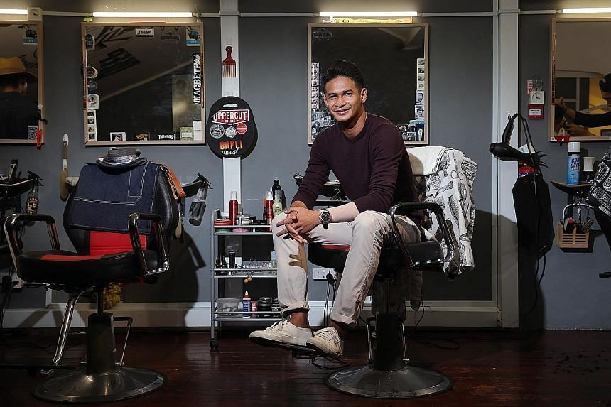 Ridhuan Muhammad at his friend's barber shop Deep Cuts, where he likes to hang out. The former national player, who has been released by Tampines Rovers, enjoys barbering as a hobby. He has now enrolled in a part-time advanced course in petrochemical