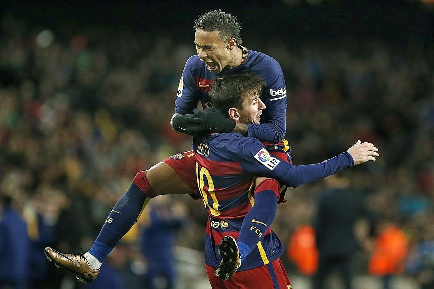 Neymar (top) celebrating a Barcelona goal with team-mate Lionel Messi. The Brazilian striker is poised to become a serious contender for the Ballon d'Or in the coming years, especially since his age of 23 is an advantage over Messi, 28, and Cristiano