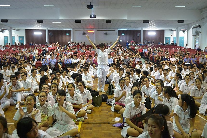 Many schools celebrated their top achievers yesterday even though the Education Ministry did not name the top scorers. At Chung Cheng High School (Main) (above), the students who had received at least five distinctions were named when principal Chan