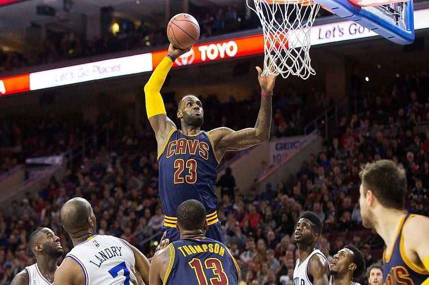 Cleveland Cavaliers forward LeBron James dunking against the Philadelphia 76ers during the first quarter at Wells Fargo Centre. The Cavaliers won 95-85.