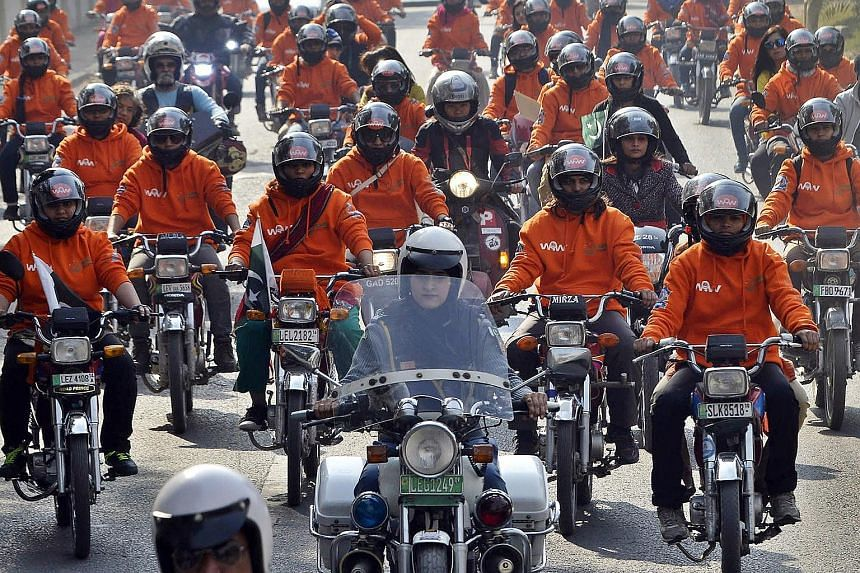 Participants of Women on Wheels (WOW) riding their motorcycles during a rally launching the campaign in Lahore, Pakistan, on Sunday. A new wave of female drivers in Pakistan is pushing the boundaries set by men in a deeply conservative Muslim country