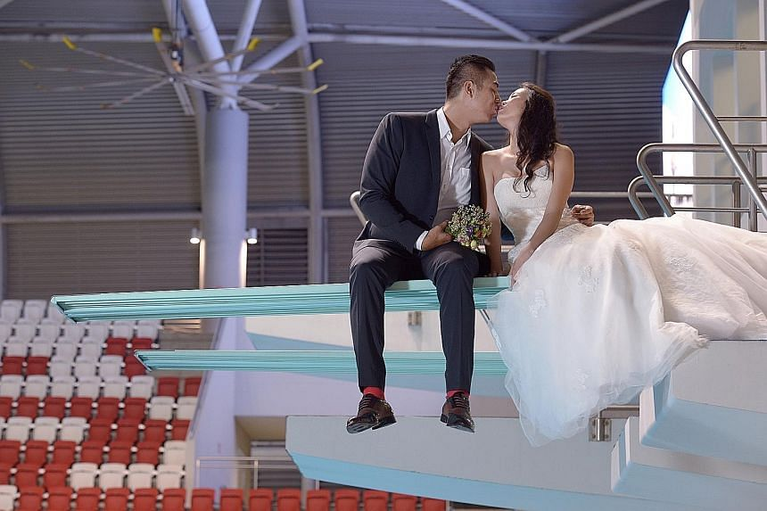 National water polo captain, Eugene Teo, 28, a marketing manager, tied the knot with Vanessa Poh, 26, a financial consultant, yesterday. The couple had their wedding pictures taken at the scene of Singapore's SEA Games triumph - the OCBC Aquatic Cent