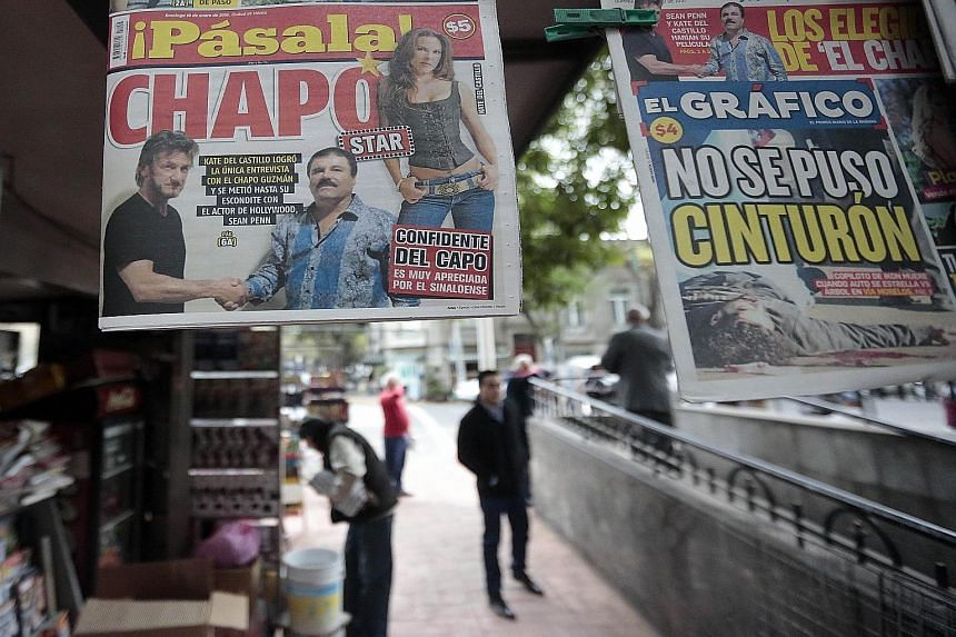 A newspaper, displayed at a newsstand in Mexico City on Sunday, shows a picture of drug lord Guzman (in blue striped shirt) with US actor Sean Penn. The actor, who wrote about his clandestine meeting with Guzman last October, has been criticised on e