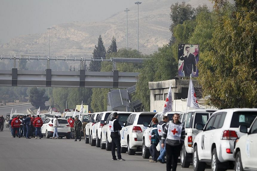 A convoy of Red Cross, Red Crescent and UN trucks gathering in Damascus yesterday before heading to Madaya, Fuaa and Kafraya. Forty-four trucks will go to Madaya carrying food, water, infant formula, blankets and medical supplies. Aid has not entered