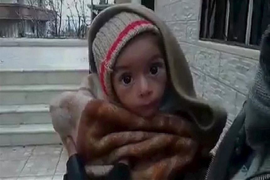 (Top) A malnourished toddler in the town of Madaya, where dozens of people have died from hunger-related causes. (Left) A Sunni man donating money for the people of Madaya as he leaves a mosque in the southern Lebanese port city of Sidon this week.