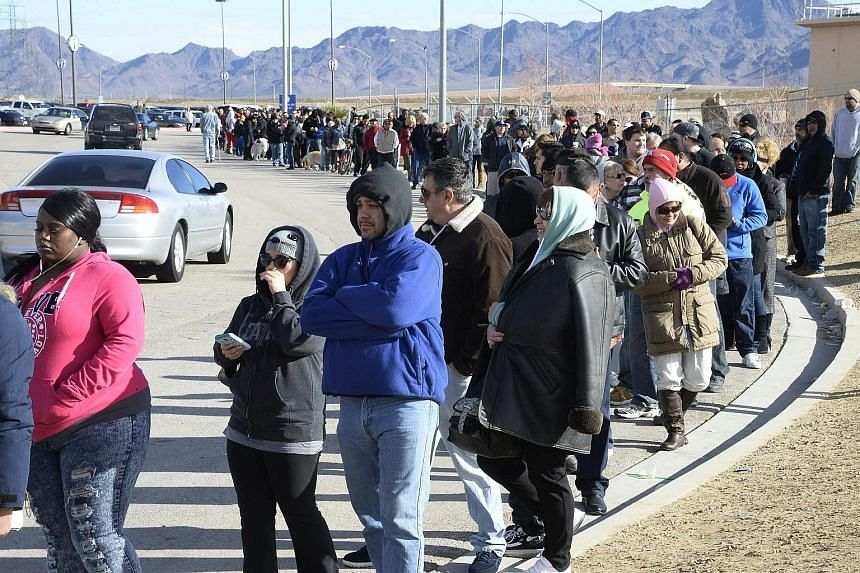 People waiting in line to purchase tickets for the Powerball lottery in San Bernardino, California, last Saturday. The odds of winning are just one in 292 million, but Americans are trying their luck, lured by the huge jackpot.
