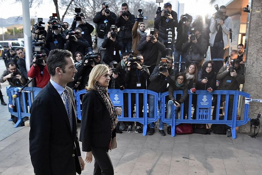 Princess Cristina and her husband Inaki Urdangarin arriving at court on the island of Majorca yesterday. Cristina has been charged with tax evasion while her husband is accused of embezzlement, influence peddling, document falsification, money launde