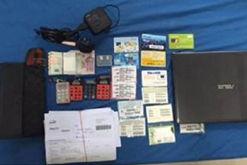 Several mobile phones, SIM cards, bank tokens and $7,500 in cash were seized from the suspect.
