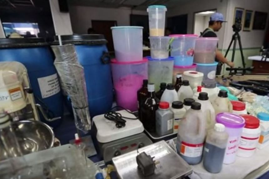 Drugs and drug-making equipment seized by the police in the Johor raid.