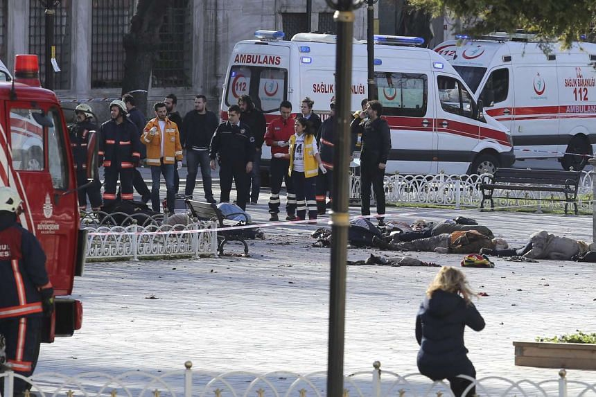 Rescue teams gather at the scene after an explosion in central Istanbul, Turkey on Jan 12, 2016.