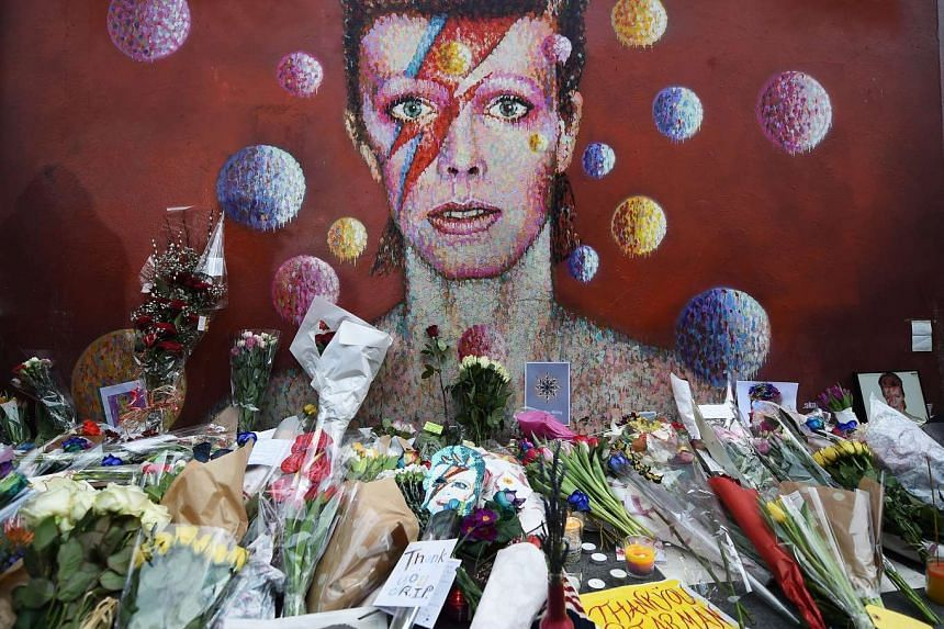 Flowers from fans at a tribute mural for David Bowie in Brixton, his birth place, on Monday.
