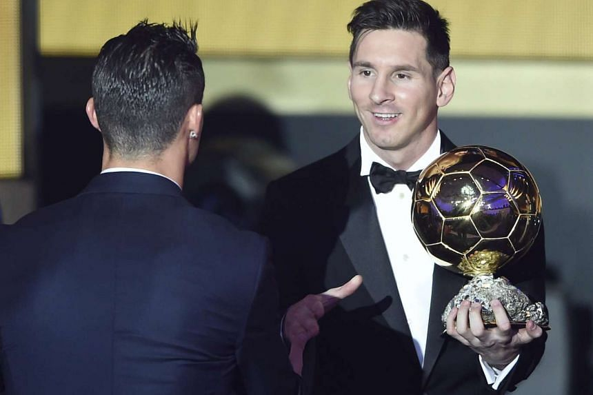 Argentina's Lionel Messi (right) is congratulated by Portugal's Cristiano Ronaldo after winning the FIFA Men's soccer player of the year 2015 prize in Zurich on Monday night.