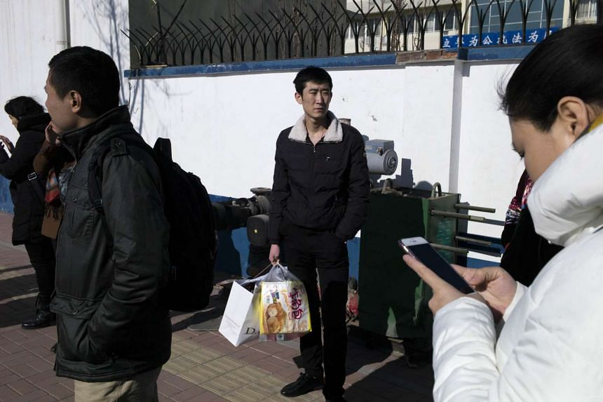 Family members of detained lawyers and their colleagues gather at the Hexi District Detention Centre on Jan 8, 2016.