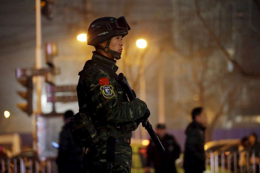 An armed policeman standing guard at the Sanlitun area in Beijing on Dec 24, 2015, after security warnings were issued for Westerners.