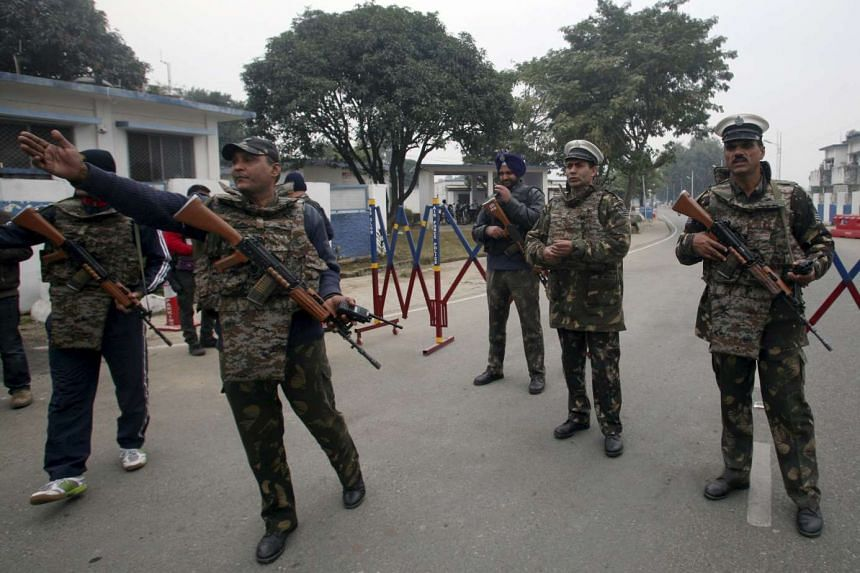 Indian security personnel standing guard inside the Indian Air Force base at Pathankot on Jan 4, 2016.
