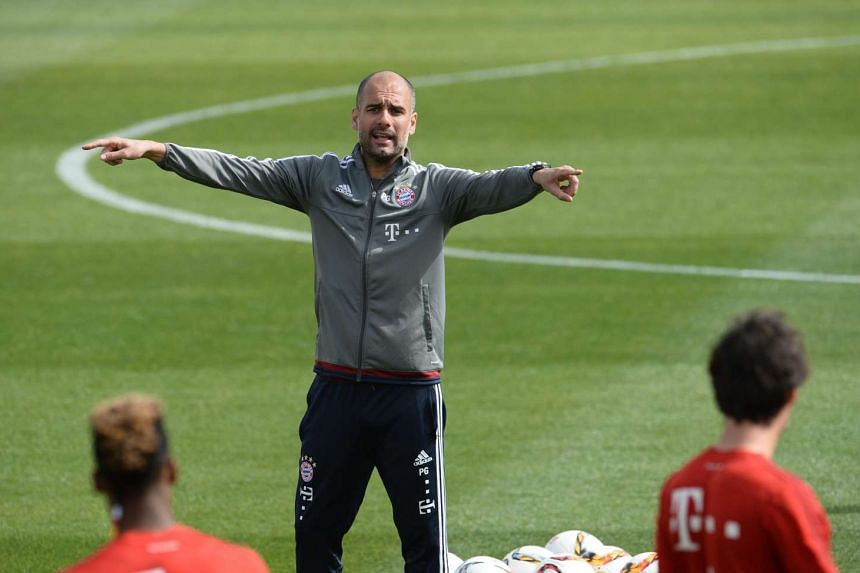 Bayern Munich's head coach Pep Guardiola gestures during a training session in Doha, Qatar, on Jan 10, 2016.